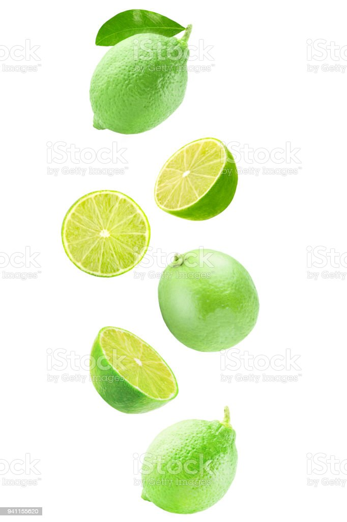 Fresh falling lime isolated on white background with clipping path - foto stock