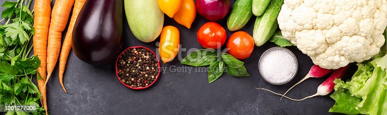 istock Fresh farmers garden vegetables on stone background. Horizontal banner. Harvest time. Top view 1201277006