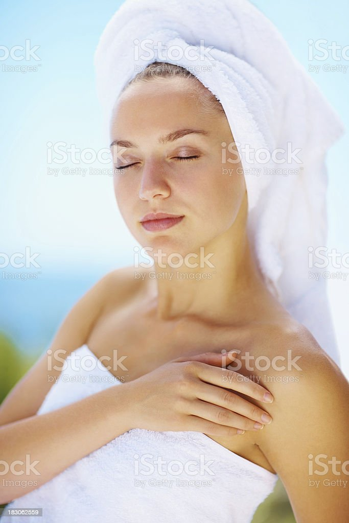 Fresh female with eyes closed wrapped in a towel royalty-free stock photo