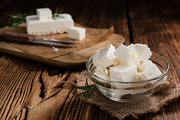 Fresh Feta Cheese Fresh Feta Cheese (detailed close-up shot) on vintage background feta cheese stock pictures, royalty-free photos & images