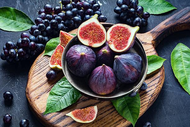 Fresh figs and black grapes Isabella stock photo