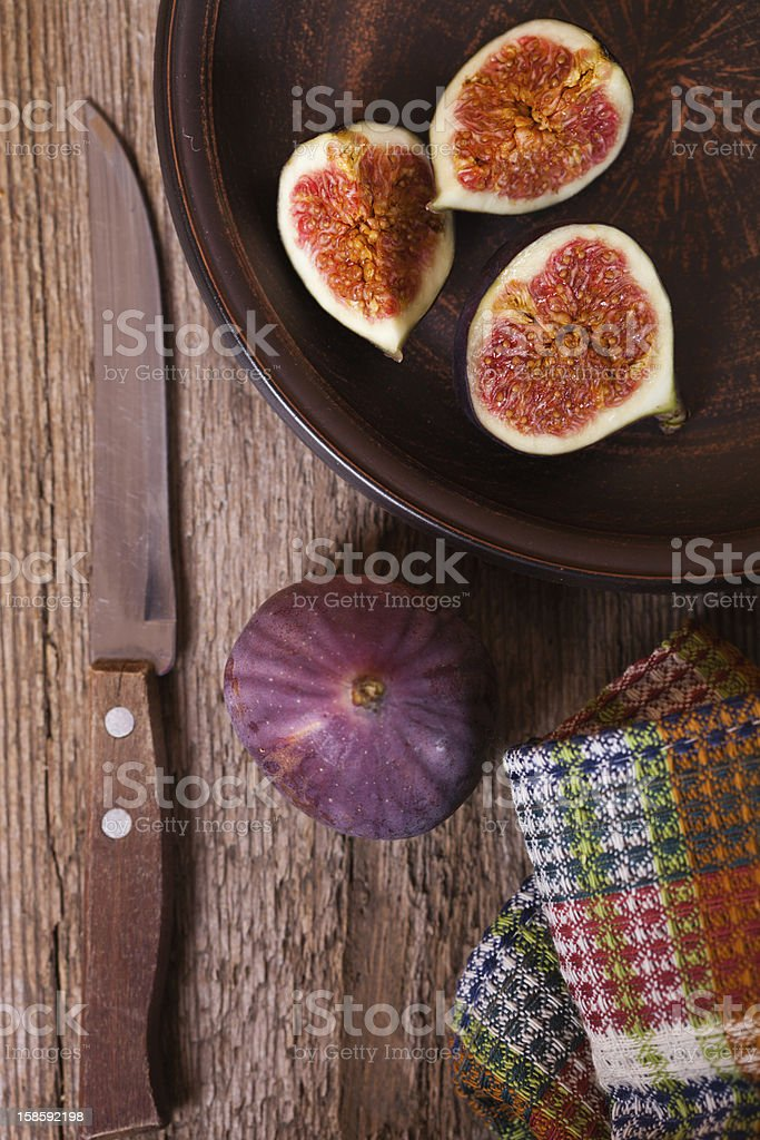 fresh figs in a plate, old knife and towel royalty-free stock photo