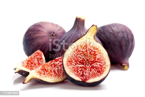 Sliced ripe figs on white background