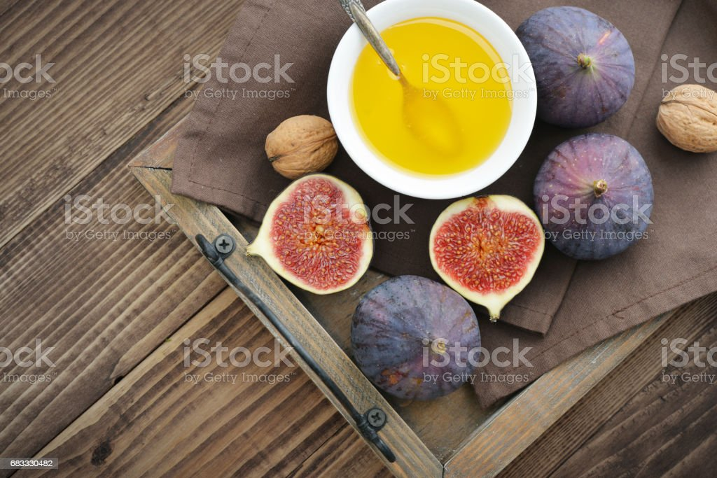 Fresh figs with honey and nuts royalty-free stock photo