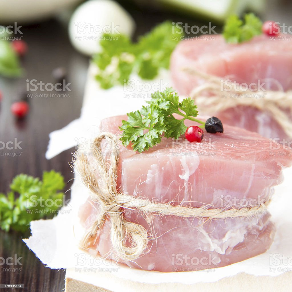 Fresh fillet of raw meat with spices and herbs royalty-free stock photo