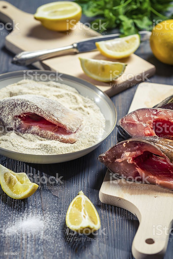Fresh fish and ingredients for her cooking royalty-free stock photo