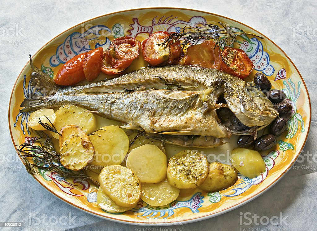 Fresh fish cooked in owen royalty-free stock photo