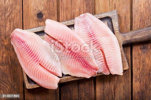istock fresh fish fillet on wooden board 914601894