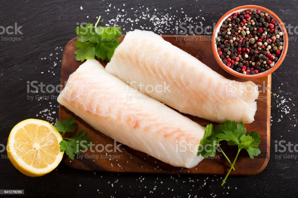 fresh fish fillet with ingredients for cooking stock photo