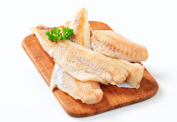 Fresh fish fillets on a cutting board stock photo