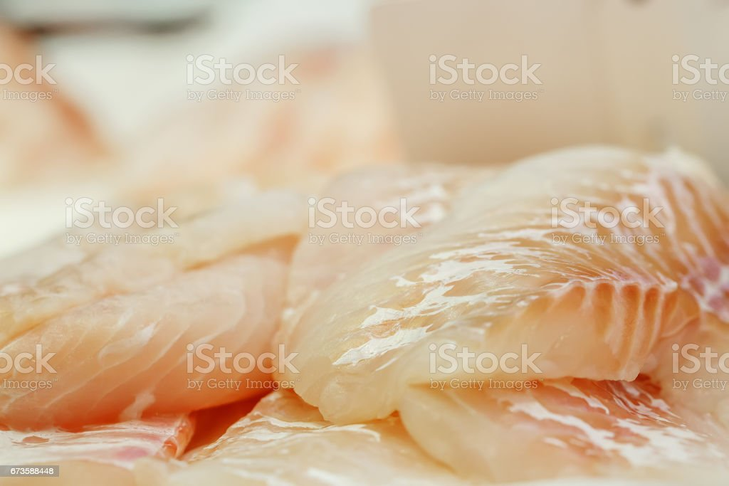 fresh Fish fillets on showcase of seafood market stock photo