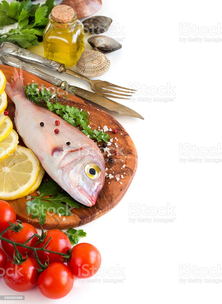 Fresh fish on a wooden board stock photo