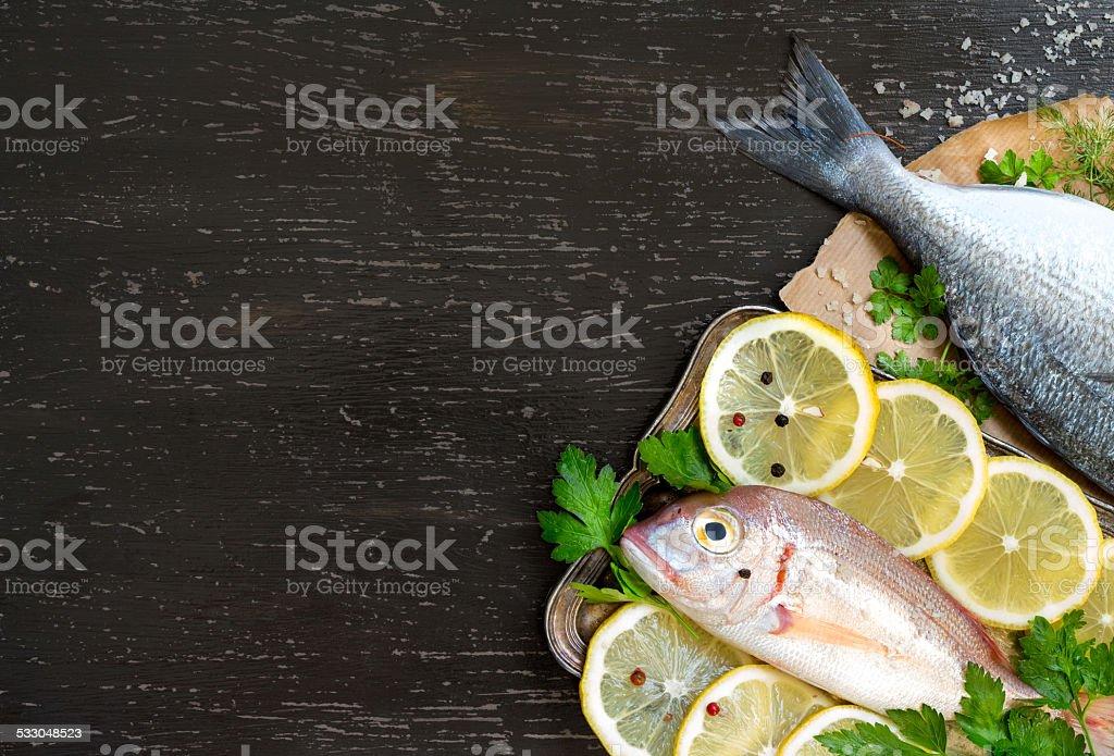Fresh fish on dark vintage background stock photo