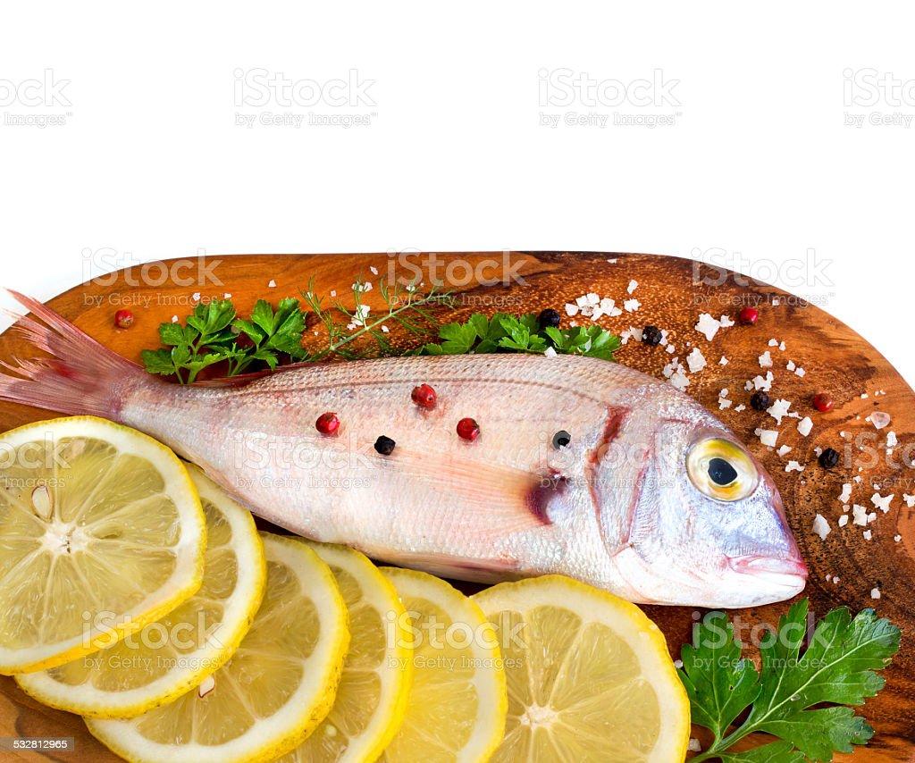 Fresh fish on wooden board stock photo