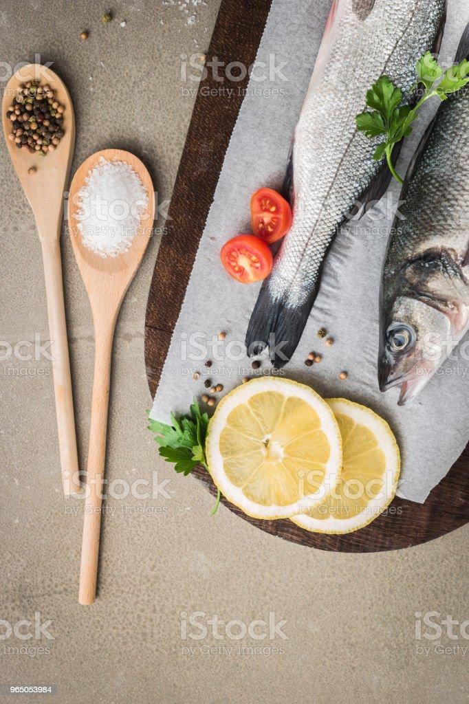 Fresh fish sea bass on wooden table zbiór zdjęć royalty-free