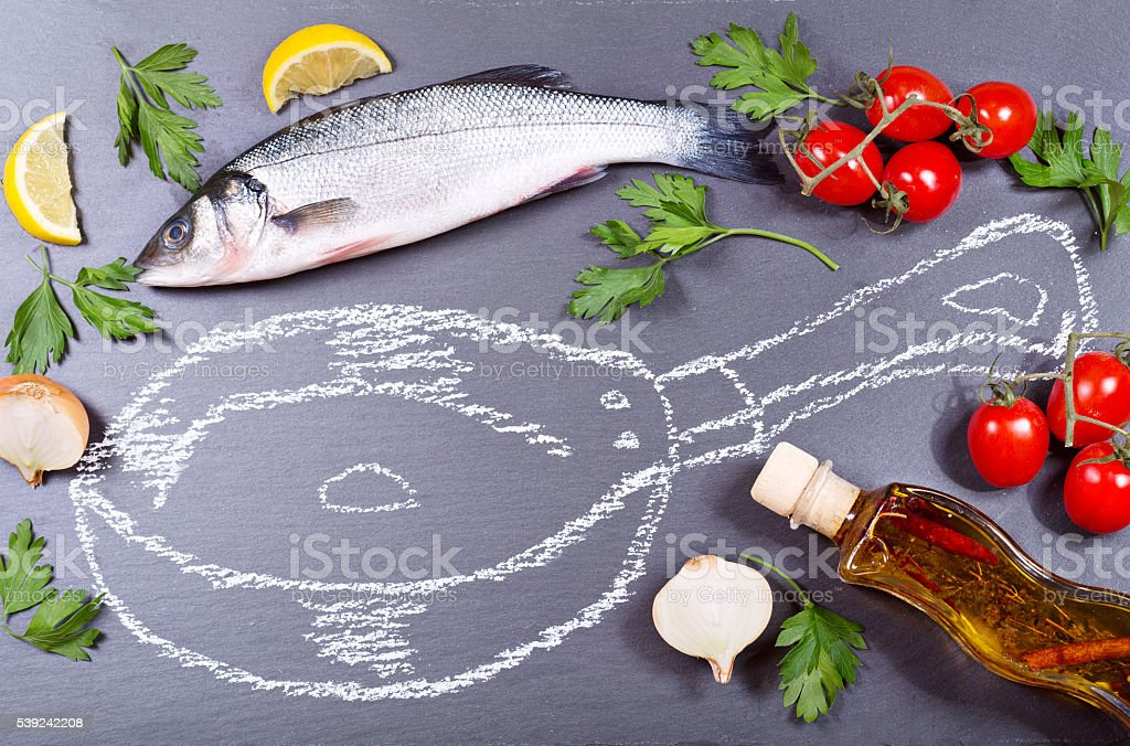 fresh fish with herbs, vegetables and painted pan royalty-free stock photo