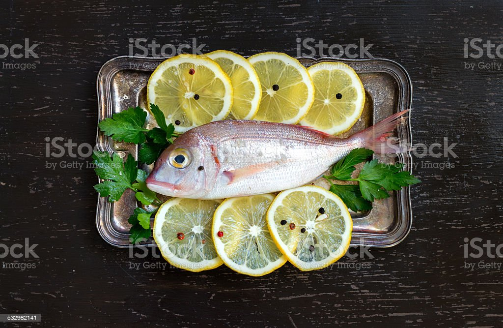 Fresh fish with lemon stock photo