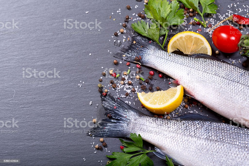 fresh fish with spices and vegetables royalty-free stock photo