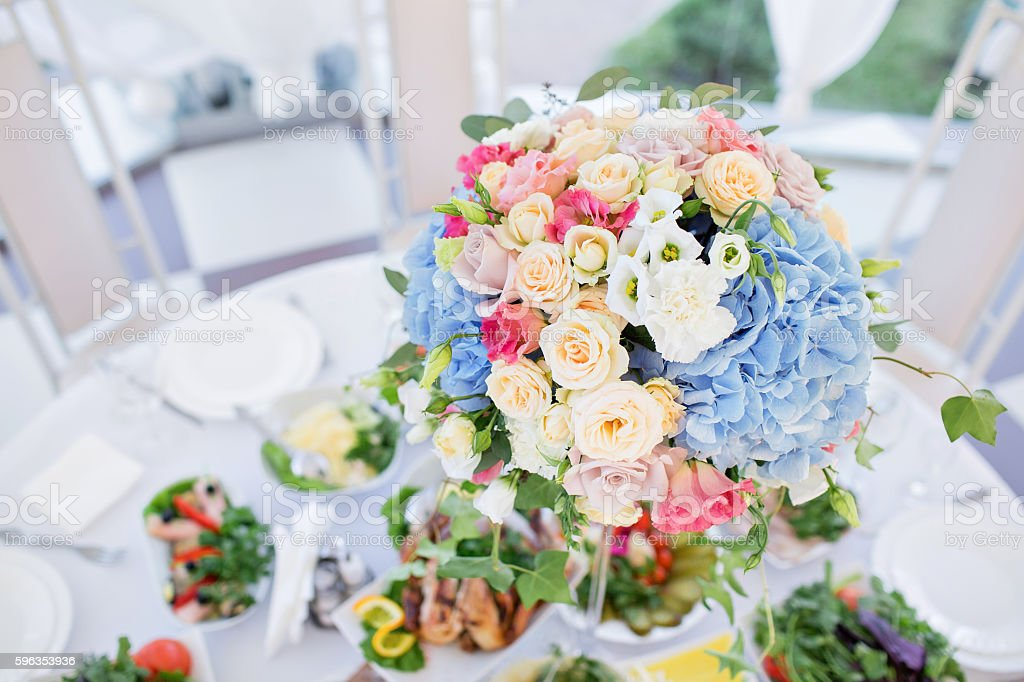 fresh floral composition on the holiday table. Beautifully organized event royalty-free stock photo