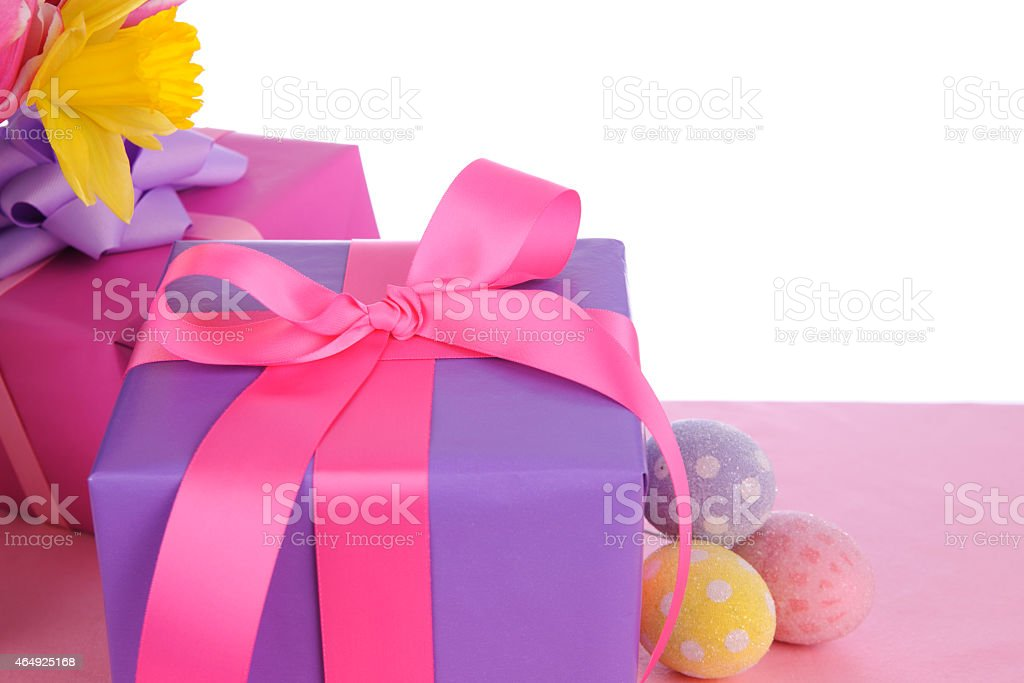 Beautiful fresh flowers and gifts with eggs on a white background.
