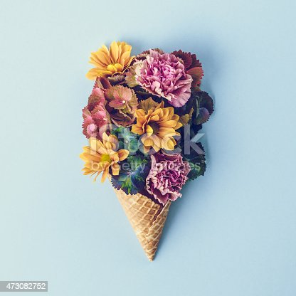 istock Fresh flowers in ice cream cone still life 473082752
