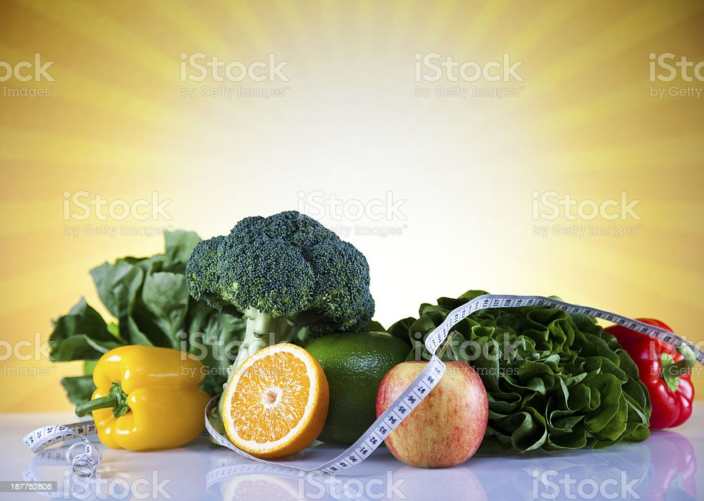 Fresh food and measure tape,Sport diet,sunset royalty-free stock photo
