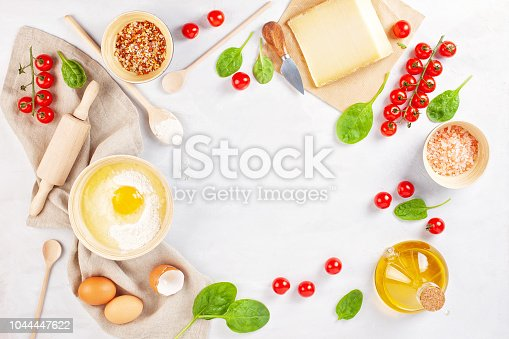 1136817041 istock photo Fresh food ingredients and kitchen utensils for pizza or salty t 1044447622