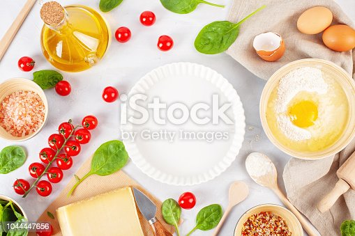 1136817041 istock photo Fresh food ingredients and kitchen utensils for pizza or salty t 1044447656