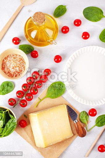 1136817041 istock photo Fresh food ingredients and kitchen utensils for pizza or salty t 1044447660