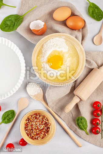 1136817041 istock photo Fresh food ingredients and kitchen utensils for pizza or salty t 1044447680