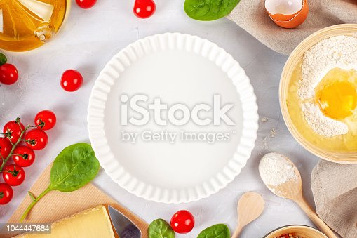 1136817041 istock photo Fresh food ingredients and kitchen utensils for pizza or salty t 1044447684