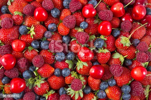 841659594 istock photo Fresh Forest fruit berries overhead assorted mix 981906510