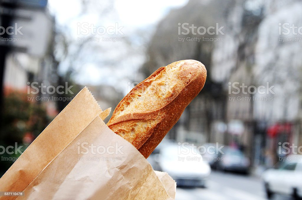Fresh French baguette with view of Paris stock photo
