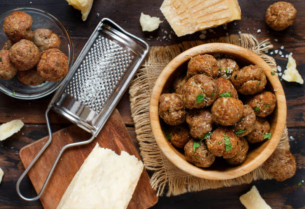 Fresh fried meatballs Fresh fried meatballs in a bowl on a wooden table meatball stock pictures, royalty-free photos & images