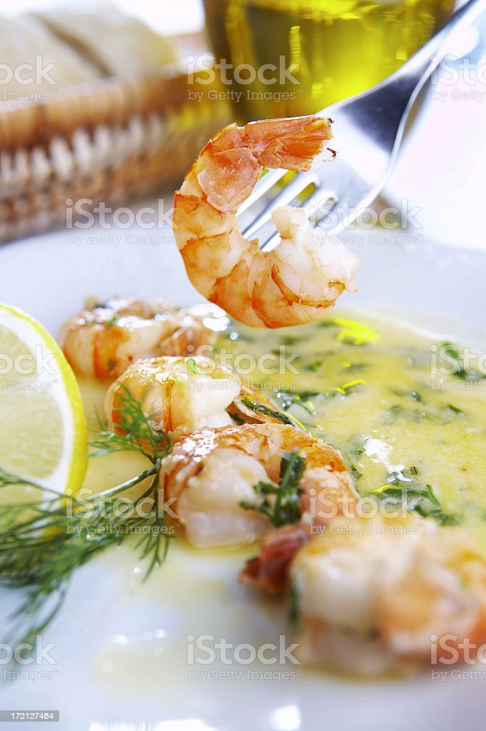 Fresh fried prawns in a delicious looking sauce royalty-free stock photo