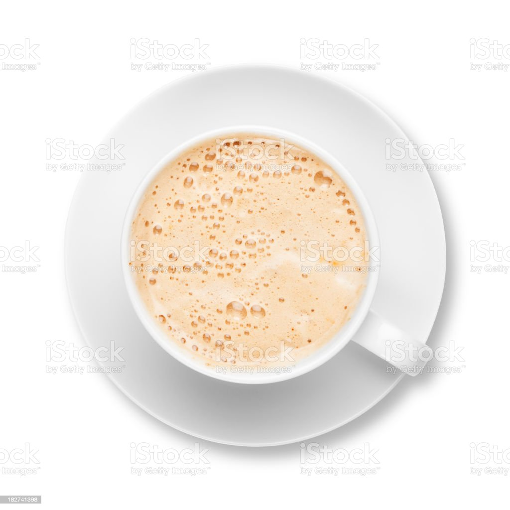Fresh frothy latte coffee in white cup with saucer stock photo