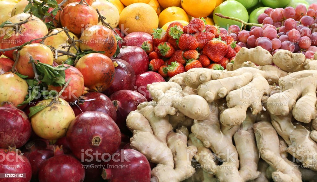 fresh fruit and in the greengrocer pomegranate ginger apples str stock photo