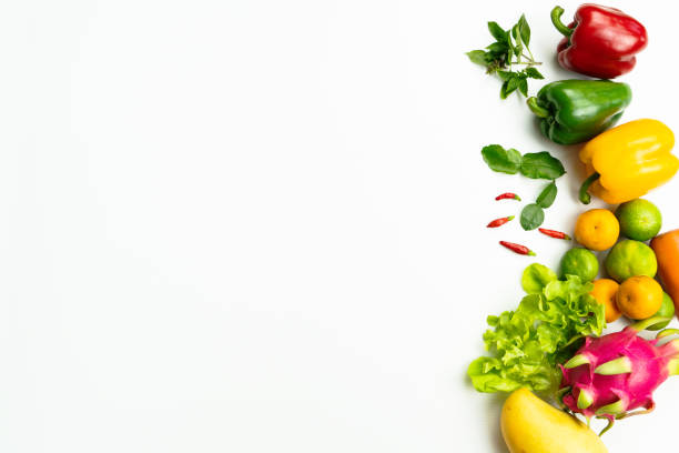 Fresh fruit and vegetable. Flat lay of fresh raw organic vegetables on white background stock photo