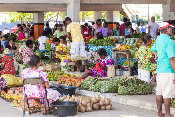 Fresh fruit and vegetable market, Port Vila, Vanuatu - January 10th 2014: Fresh fruit and vegetable market. The daily market sells fresh local produce. vanuatu stock pictures, royalty-free photos & images