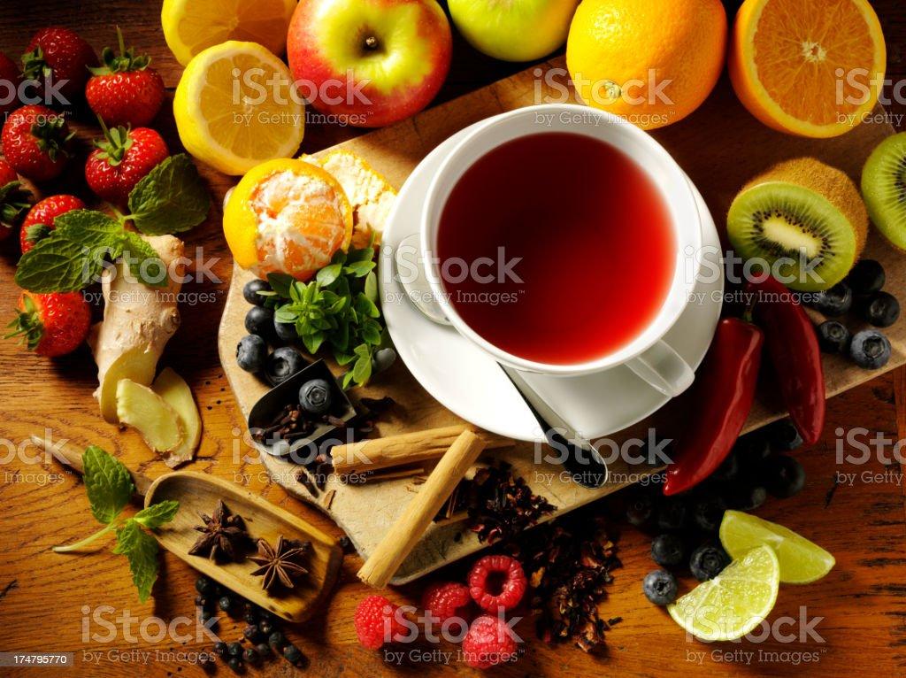 Fresh Fruit around a Cup of Tea stock photo