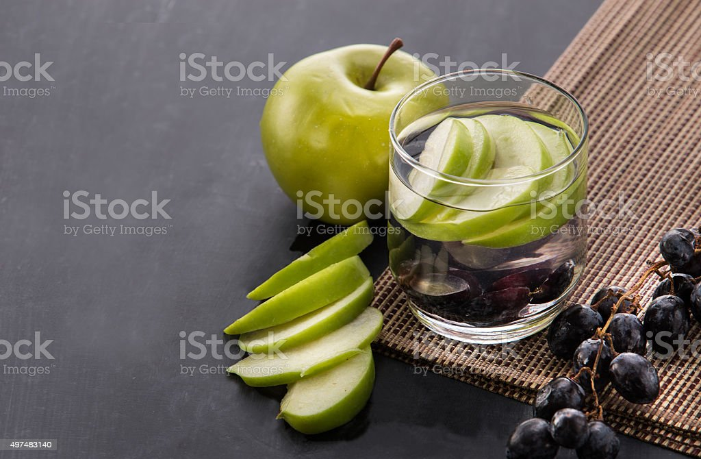 fresh fruit Flavored infused water mix of apple and grape stock photo