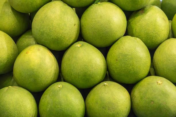 Fresh Fruit Green Grapefruit on Shelf in Fresh Fruit market Thailand Travel Background Concept stock photo