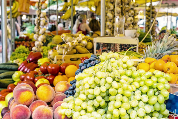 Fresh fruit in market hall, old town Trogir, Croatia Fresh fruit in market hall, old town Trogir, Croatia. Food theme. Travel destination. Yellow photo filter. market hall stock pictures, royalty-free photos & images