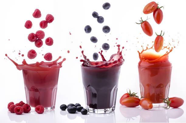 éclaboussure de légumes et de jus de fruits frais - jus de fruit photos et images de collection