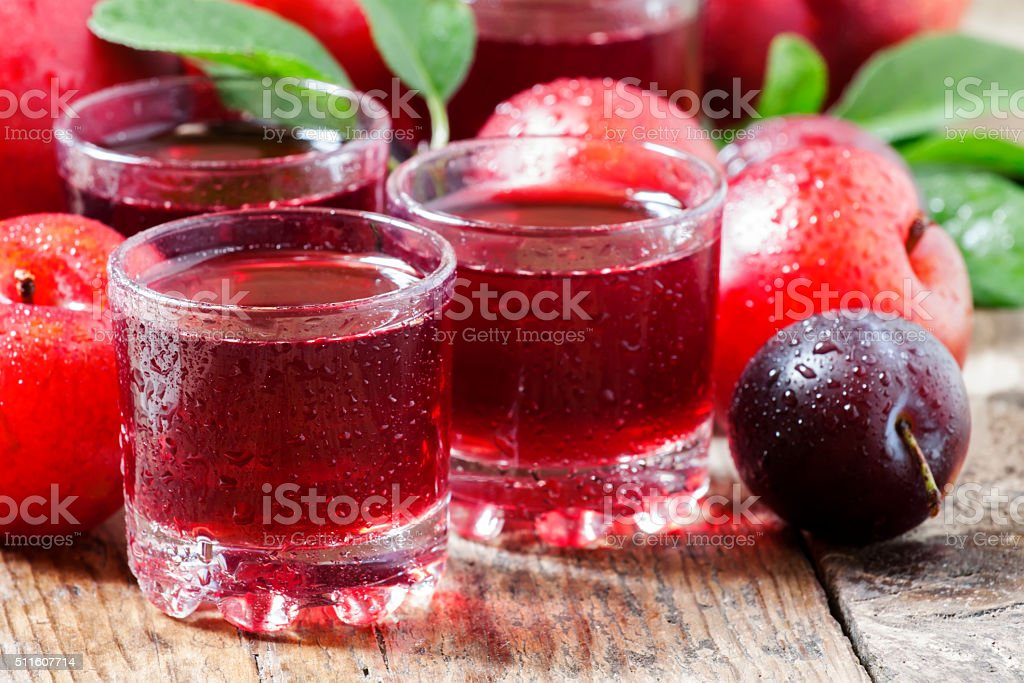 Fresh fruit juice of red plums and peaches stock photo