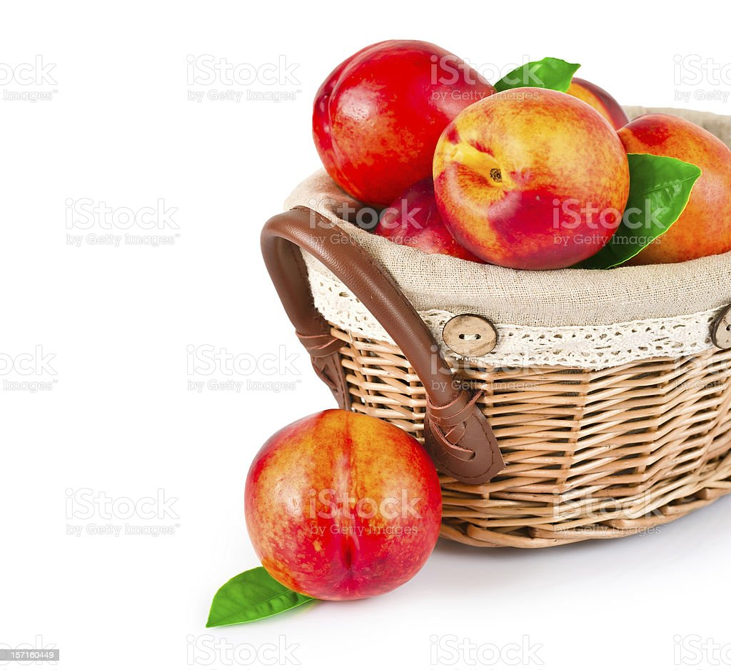 Fresh fruit nectarines in the basket royalty-free stock photo