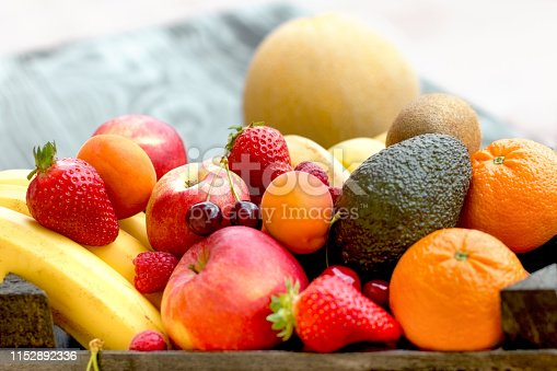 istock Fresh fruit, organic fruits close-up on rustic table 1152892336