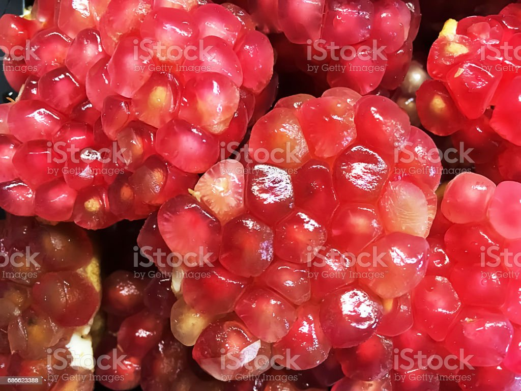 Fresh fruit Pomegranate open to reveal the clusters of juice,gem-like seeds on the inside. royalty-free stock photo