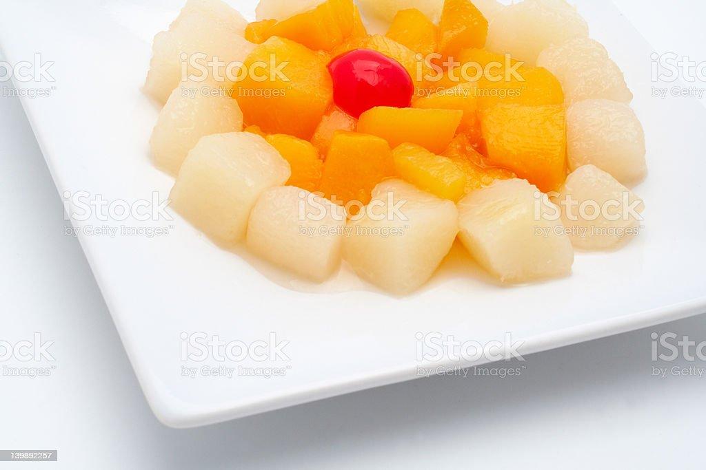 Fresh fruit salad on the white plate stock photo
