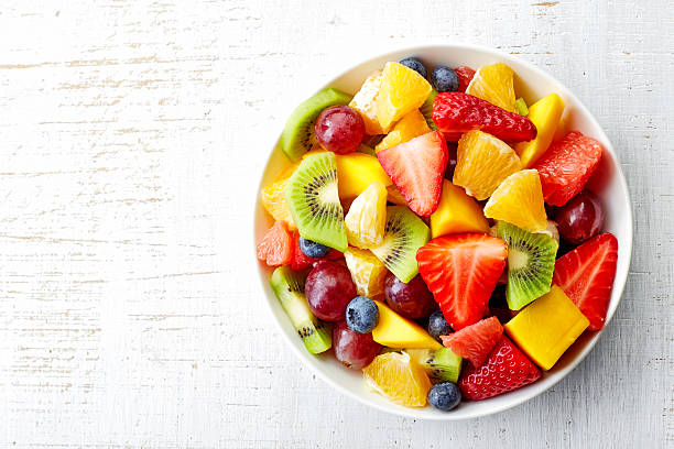 fresh fruit salad - fruit stock photos and pictures